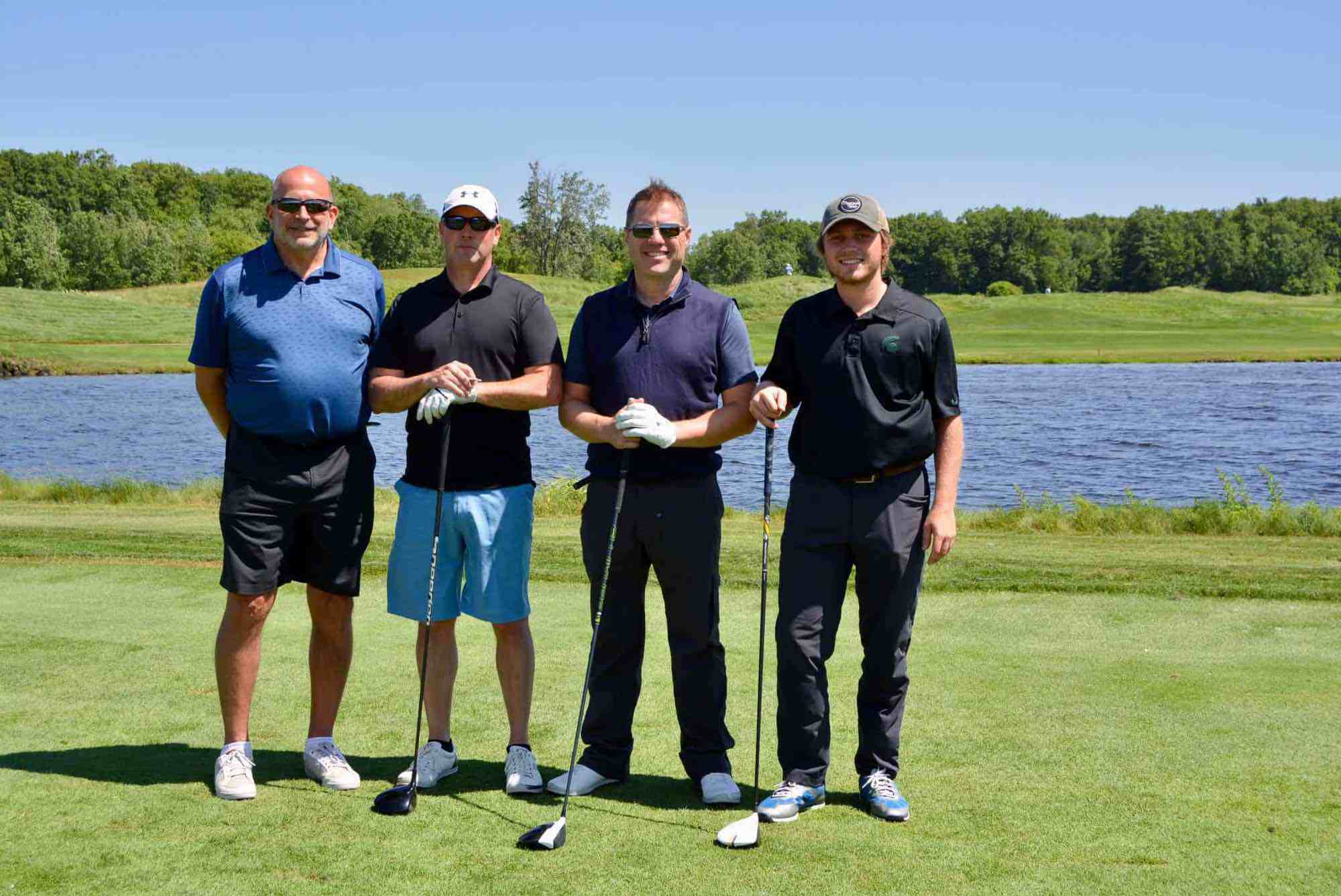 PIONEER CONSTRUCTION FOURSOME (Left to right): Randy Zandbergen, Steve Hansma (Closes to the Flag Winner), Tim Schowalter, Sam Schowalter