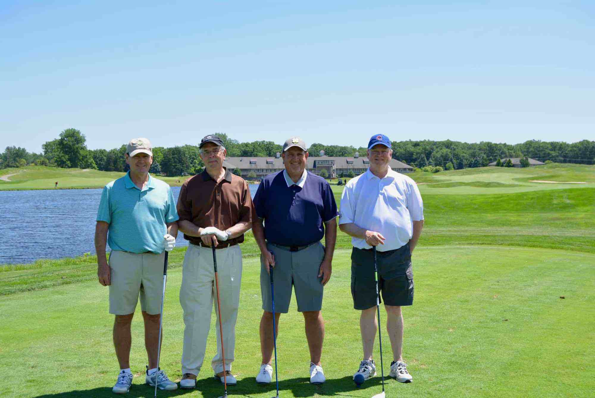 RHOADES MCKEE FOURSOME (Left to right): Tom Hogan, John Lichtenberg, Brian Boerighter, Dan Lennon (Winner of the Longest Putt)