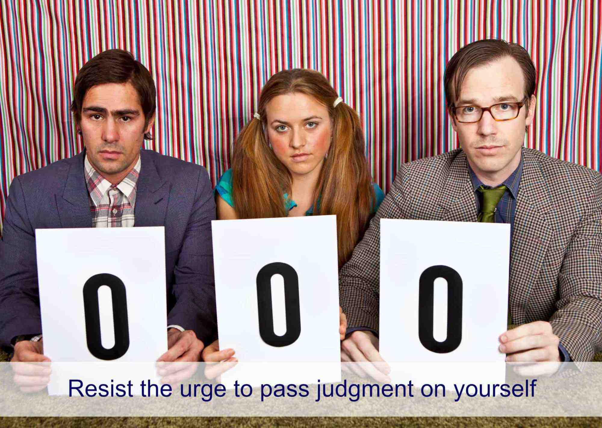Three judges holding up 0 rating cards