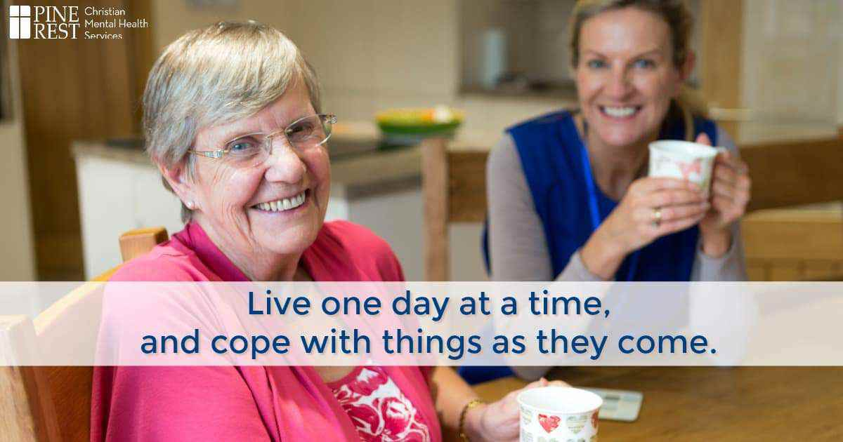 Elderly woman enjoys coffee in kitchen with daughter