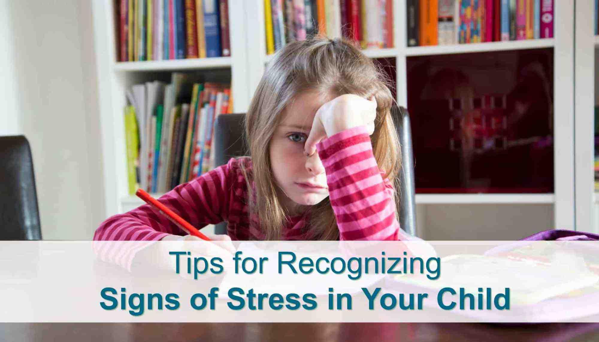 Stressed out little girl doing homework