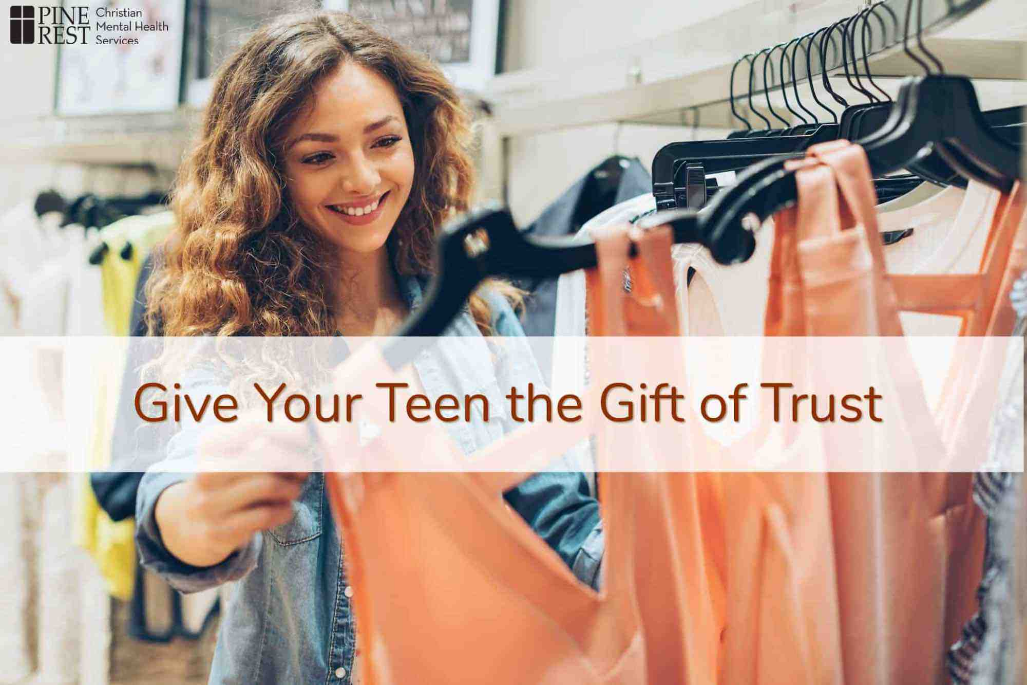 Smiling teen girl shopping for clothes