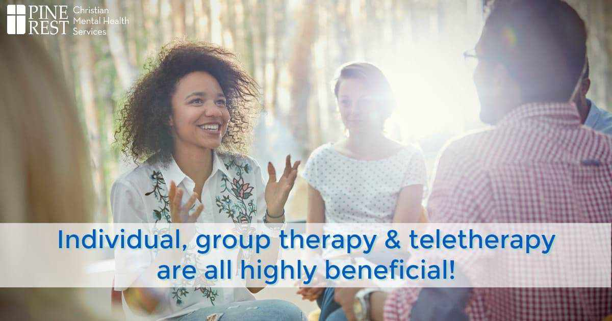 Smiling woman talking and gesturing in group therapy session