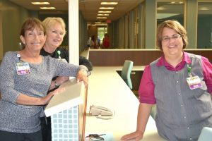 Staff at Older Adult Unit nurses station in the Van Andel Cook Center for Dementia & Geriatric Behavioral Health during open house in 2014.