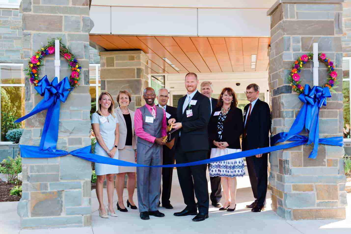 Staff ribbon cutting at Cypress Open House